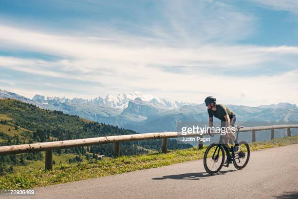cyclist at the top of col de joux plane - europe stock pictures, royalty-free photos & images