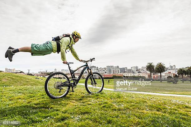 Cyclist balancing body on bike