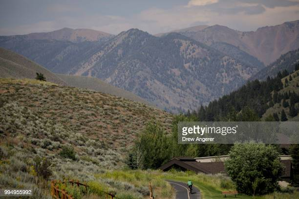 A cyclist bikes along a trail near Sun Valley Resort ahead of the annual Allen Company Sun Valley Conference July 9 2018 in Sun Valley Idaho Every...