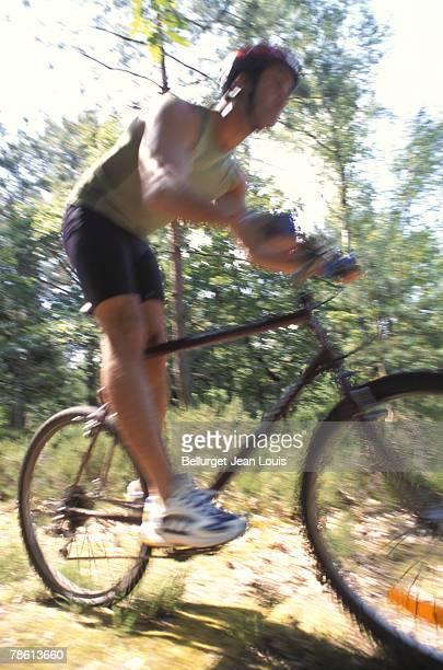 Cyclist biking on trail