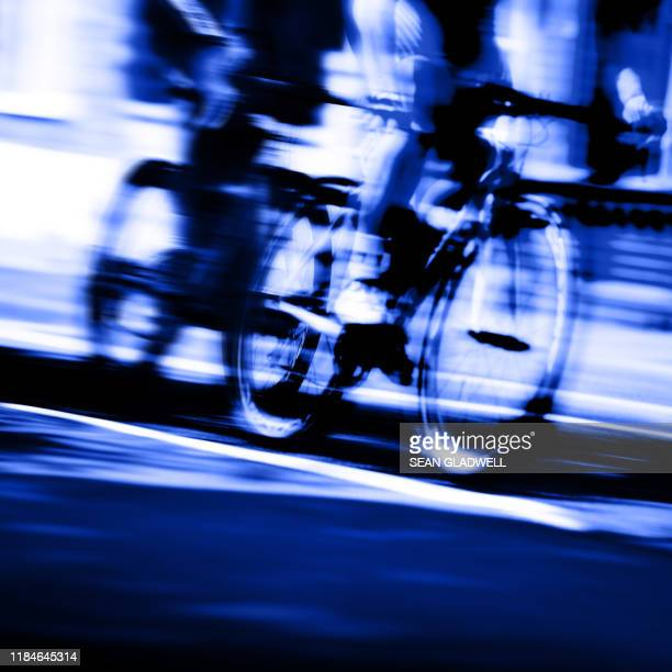 cyclist blur - road race stock pictures, royalty-free photos & images