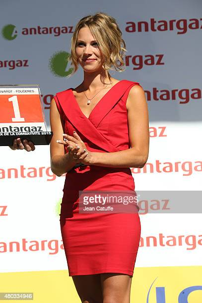 Cyclist champion Marion Rousse works as an hostess on the podium following stage seven of the 2015 Tour de France a 1905 km road stage from Livarot...