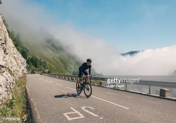 cyclist climbing the last km of col de la colombière - adults only stock pictures, royalty-free photos & images