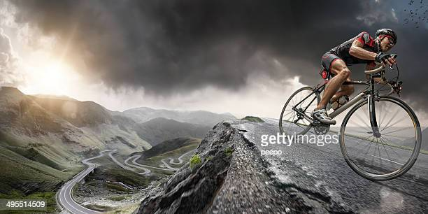 cyclist climbs to the top - bicycle stock pictures, royalty-free photos & images