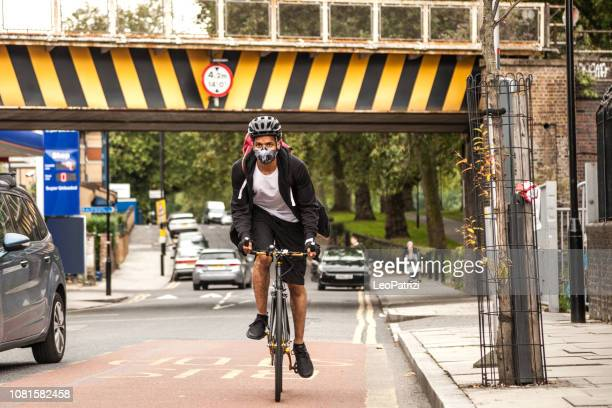 Cyclist commuter wearing a pollution-mask in Central London