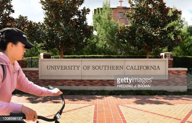 A cyclist commutes at the University of Southern California in Los Angeles California on March 11 where a number of southern California universities...