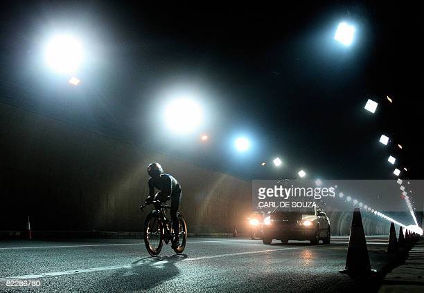 Cyclist competes in the men's Individual Time Trial cycling event during the 2008 Beijing Olympic Games, near the Great Wall in Juyongguan, 78 km...