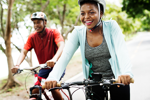 Cyclist couple riding together in a park 1030238826