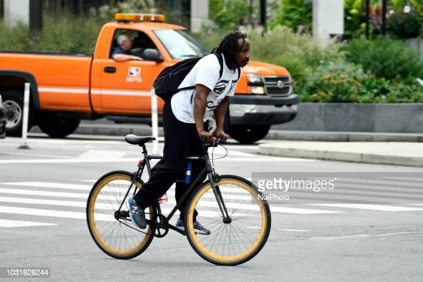 Cyclist crosses a Center City street in Philadelphia PA on September 11 2018