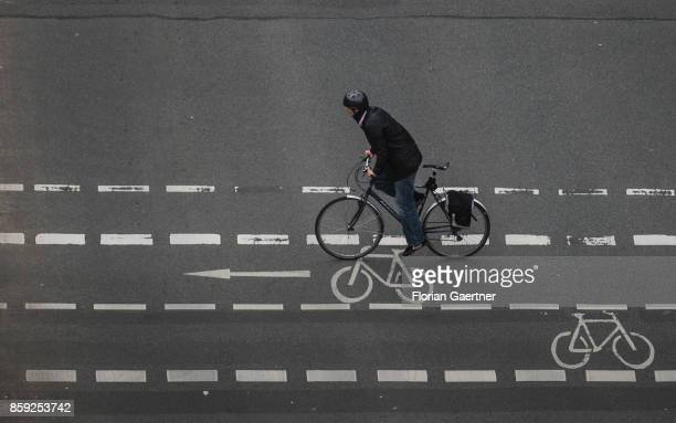 A cyclist crosses a street on the cycle lane on October 07 2017 in Berlin Germany