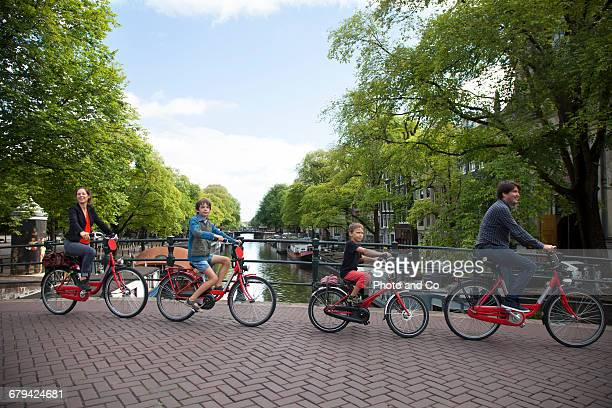 Cyclist crossing a canal bridge, Family