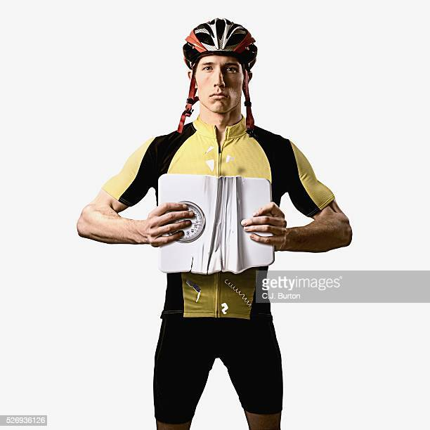 Cyclist crushing a weight scale