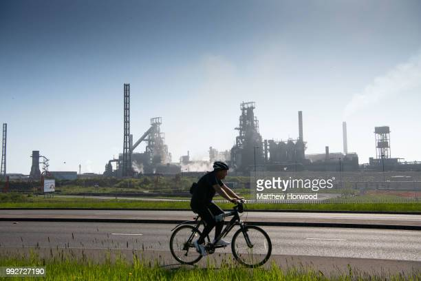 A cyclist cycles past Tata Steel steelworks on May 06 2018 in Port Talbot United Kingdom Tata and ThyssenKrupp have announced plans to merge the...