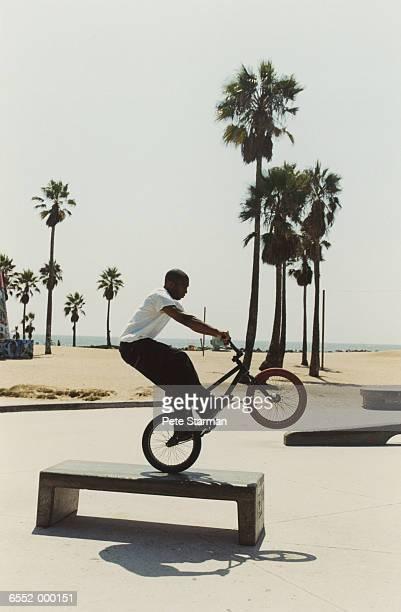 BMX Cyclist doing Wheelie