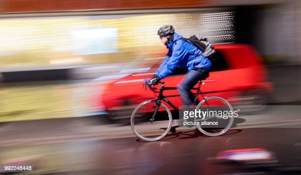 Cyclist drives across a cycling path in Hanover, Germany, 27 November 2017. The General German Automobile Club examined city resident's satisfaction...