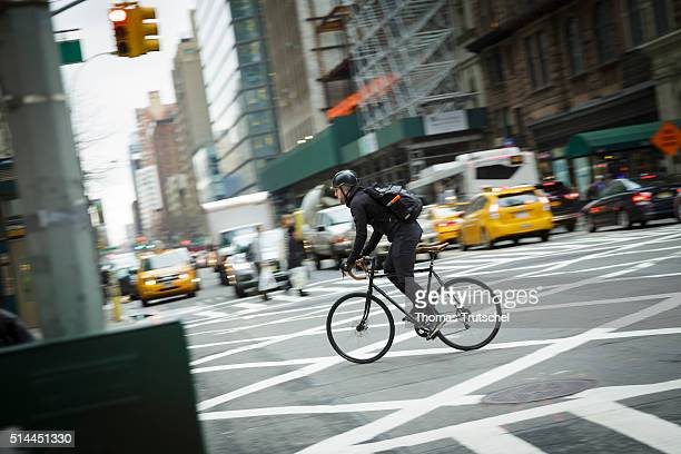 New York United Sates of America February 25 A cyclist drives in New York by an intersection on February 25 2016 in New York Germany