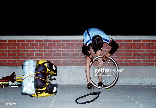 Cyclist fixing flat tire