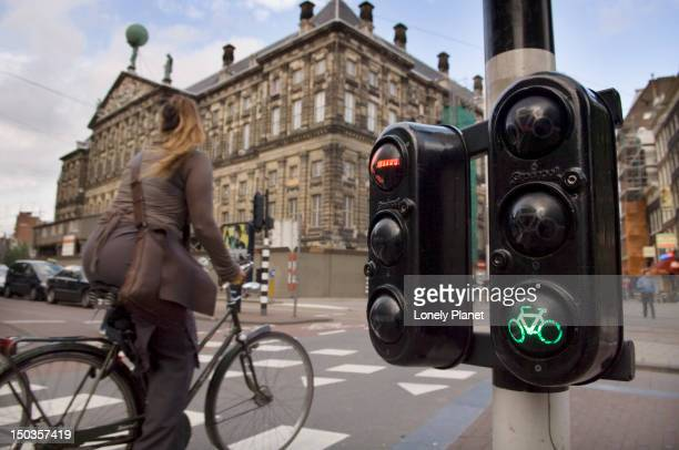 Cyclist gets green light outside the Royal Palace.