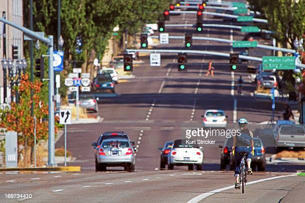 CONTENT] A cyclist glides in a bicycle lane across the Burnside Bridge and then down Burnside Street towards Northeast Portland Oregon Portland is...