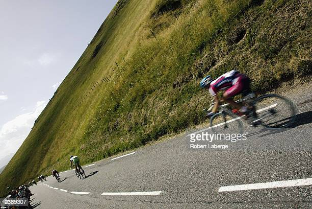 Cyclist goes down the last descent leading to Loudenvielle-Le-Louron during stage fourteen between Saint-Girons and Loudenvielle-Le-Louron, of the...