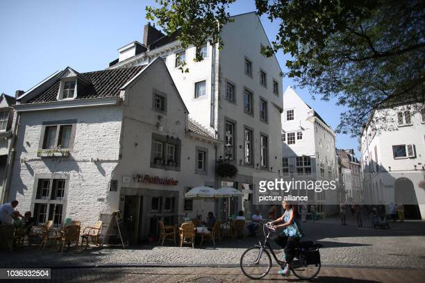 A cyclist goes through the historic city center in Maastricht The Netherlands 04 September 2013 Maastricht is applying for the European Capital of...
