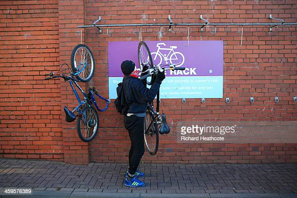 A cyclist hangs a bike in the designated bike rack ahead of the Barclays Premier League match between Aston Villa and Swansea City at Villa Park on...