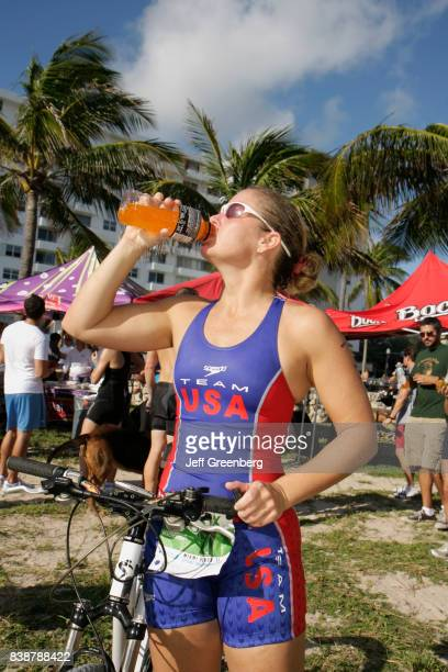 A cyclist having a drink at the Publix Family Fitness Weekend event at Lummus Park