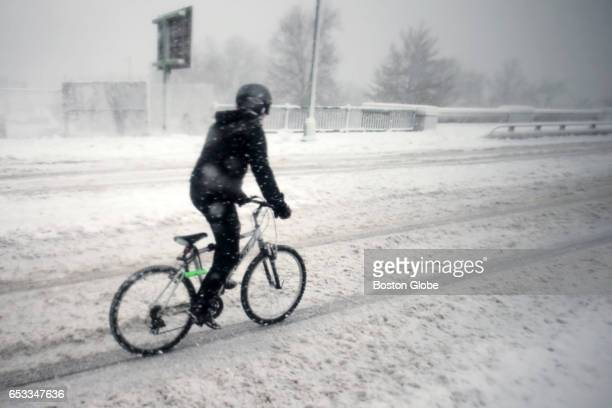A cyclist heads to the BU bridge during a winter storm in Boston on Mar 14 2017