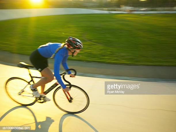Cyclist in action on velodrome track