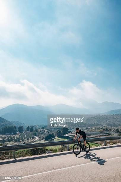 cyclist in costa blanca countryside - alicante fotografías e imágenes de stock