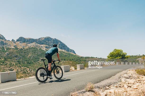 cyclist in hills above calpe, costa blanca, spain - alicante stock pictures, royalty-free photos & images