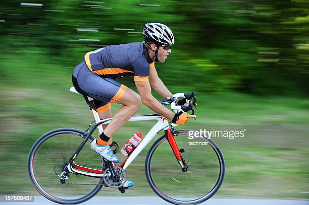 cyclist in the action - racing bicycle stock pictures, royalty-free photos & images