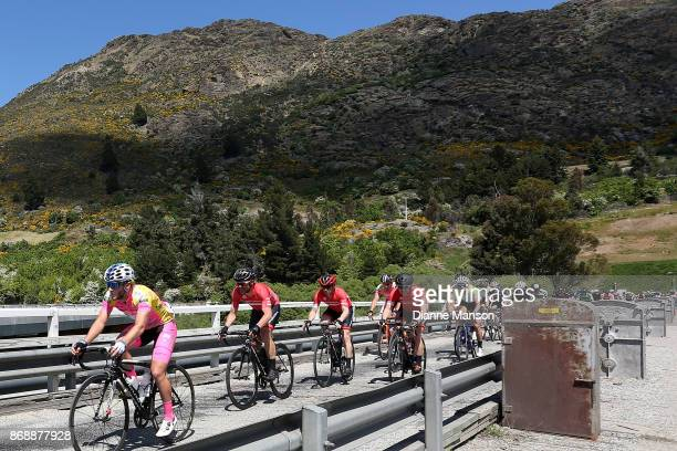 Cyclist in the main peloton make their way over the bridge towards Frankton during stage 3 from Mossburn to Coronet Peak during the 2017 Tour of...