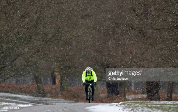Cyclist in the snow in Richmond Park on February 09, 2021 in London, England. A Met Office Weather Warning remains in place for many parts of the UK.