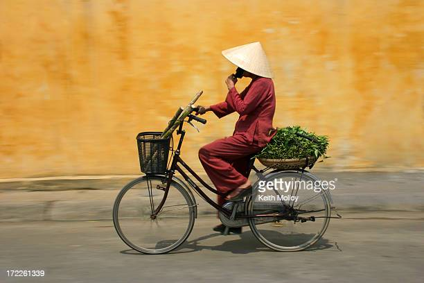 cyclist in vietnam - traditionally vietnamese stock pictures, royalty-free photos & images