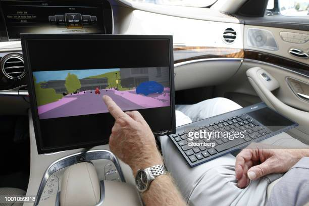 A cyclist is colorcoded on a monitor inside a MercedesBenz SClass automobile during the Daimler AG Tech Day autonomous driving and artificial...