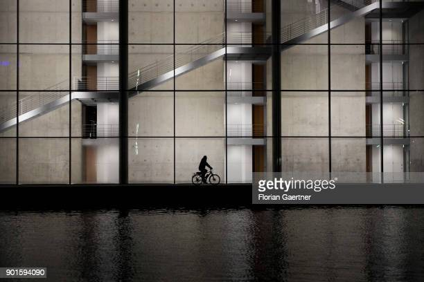 A cyclist is pictured in front of the PaulLoebeHaus on January 05 2018 in Berlin Germany