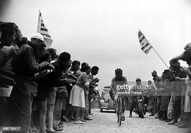 Cyclist Jean Robic at the top of the Aubisque pass supported by the crowd during mountain stage in the Pyrenees in July 1949 in France