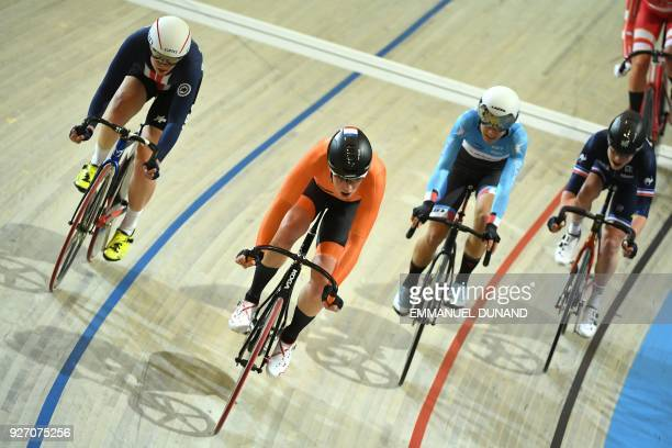 US cyclist Jennifer Valente and Netherlands Kirsten Wild take part in the women's points race final during the UCI Track Cycling World Championships...
