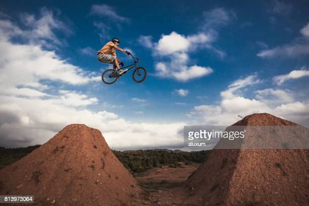 BMX cyclist jumping high. Real jump.