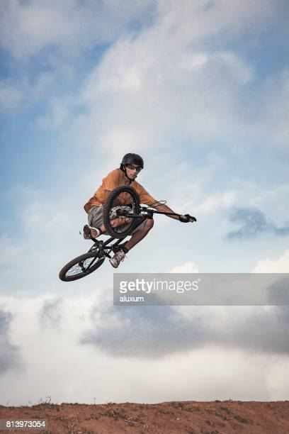 bmx cyclist jumping - bmx cycling stock pictures, royalty-free photos & images