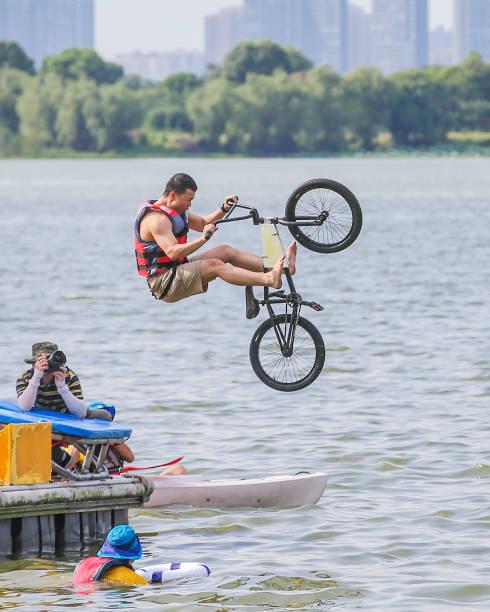 CHN: Wuhan People Jump Lake For Fun