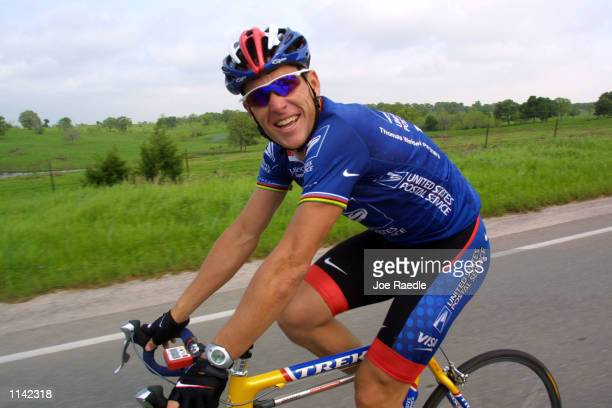 Cyclist Lance Armstrong pedals through the countryside during the Ride for the Roses bike ride April 8 2001 in Austin Texas The event raises money...