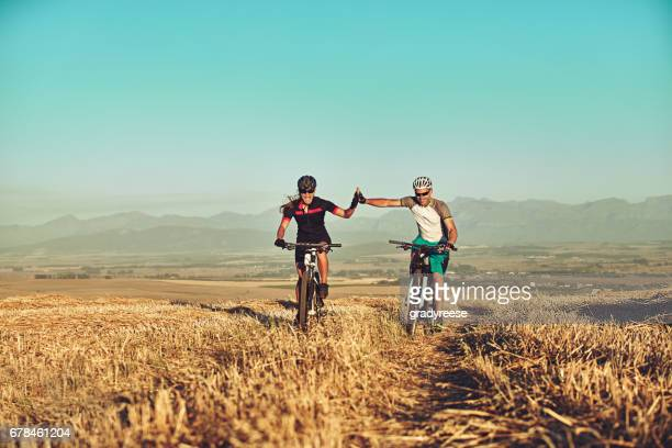 cyclist make better lovers - cross country cycling stock pictures, royalty-free photos & images
