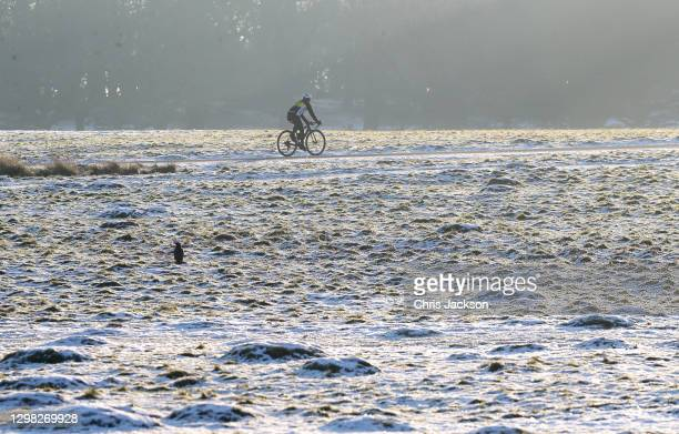 Cyclist makes his way through the remains of snow in Richmond Park on January 25, 2021 in London, England. Parts of the country saw snow and icy...