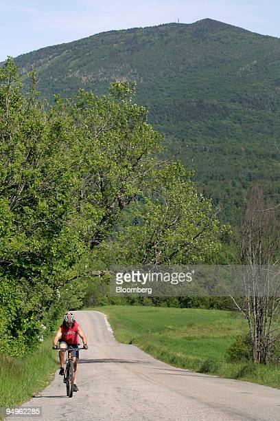 A cyclist makes his way up a hill near Burke Mountain on the Kingdom Trails in East Burke Vermont US on Wednesday June 17 2009 Kingdom Trails...