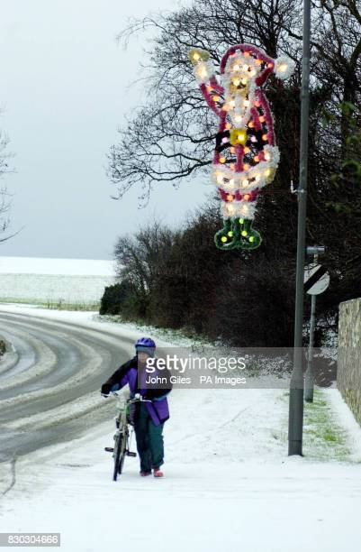 A cyclist makes their way along the roads in Towton near Tadcaster after heavy snows overnight