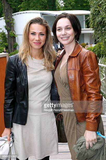 Cyclist Marion Rousse and artistic ice skater Nathalie Pechalat attend the 2016 French Tennis Open Day Five at Roland Garros
