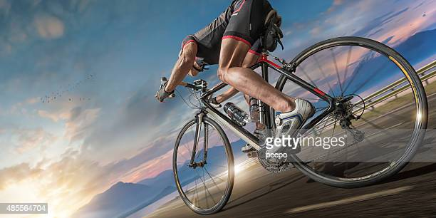 cyclist moving fast on coastal path - cycling stock pictures, royalty-free photos & images