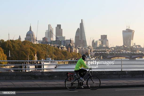 A cyclist negotiates rush hour traffic in central London on Waterloo Bridge on November 15 2013 in London England Over the course of the past 10 days...
